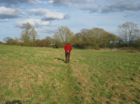 Richard walking across the field