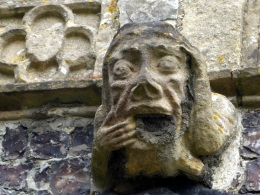 Man with a toothache on north side of the church