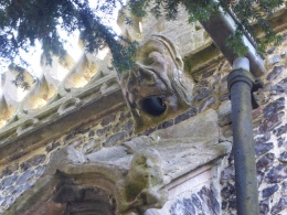 Grotesque on north side of the church